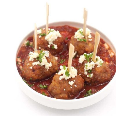 Spanish-style meatballs sprinkled with crumbled feta and chopped parsley