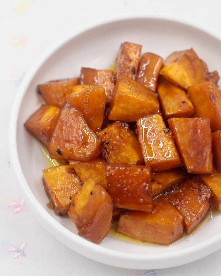 Top of of baked brown sugar-glzed potatoes in white bowl