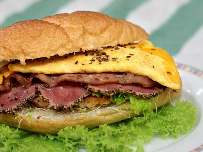 Carnivore's dream sandwich with chicken, beef, pork and egg filling