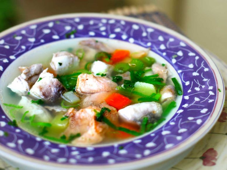 Russian fisherman's soup (ukha) with salmon, trevally, carrots, leeks