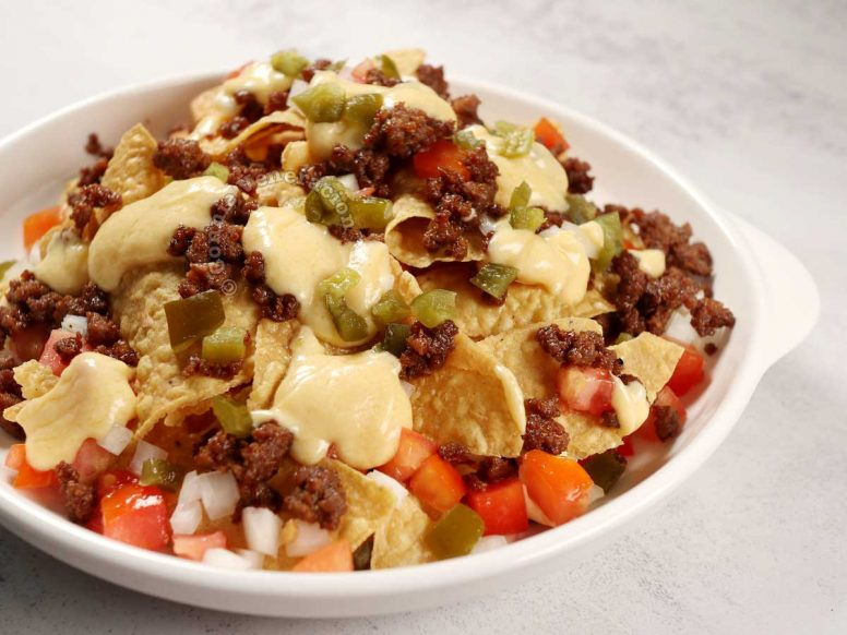 Nachos with beef and cheese sauce