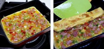 Eggs in pan sprinkled with finely sliced scallions, chopped bell pepper and ham