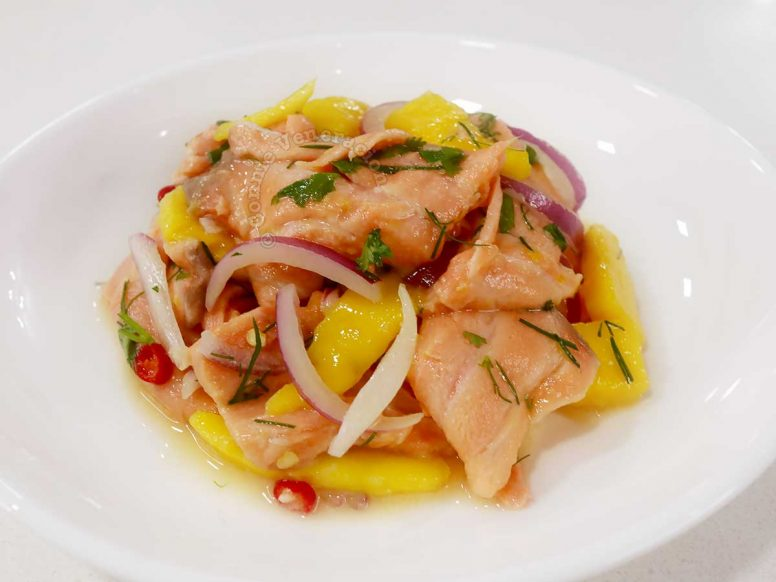 Salmon ceviche in white shallow bowl