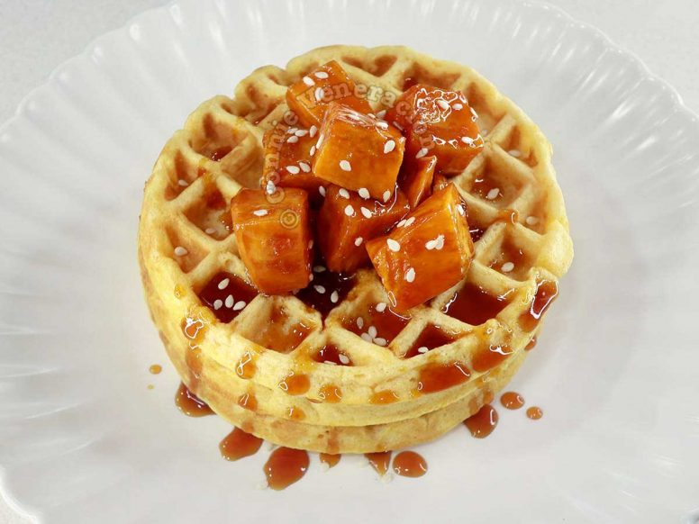 Sweet potato waffles topped with candied sweet potatoes