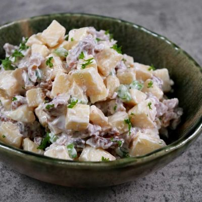 Apple chicken salad sprinkled with parsley