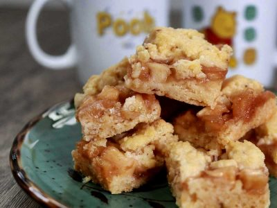 Apple crumble bars stacked on green plate