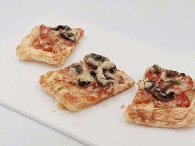 """Mushroom Puff Pastry """"Pizza"""" Cut into Squares"""