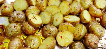 Roasted baby potatoes with chili, rosemary and garlic straight out of the oven