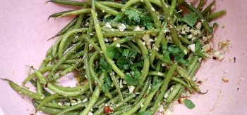 Haricot vert (French green bean) salad topped with mint leaves