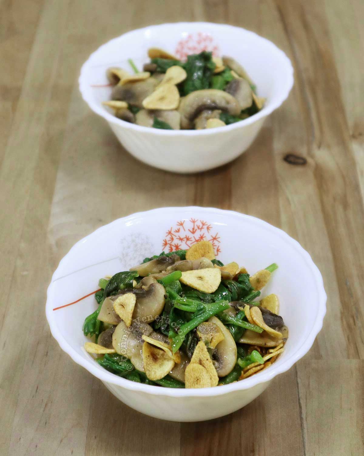 Garlic Butter Spinach and Mushrooms in Two Small White Bowls